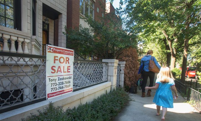 A home is offered for sale in the Bucktown neighborhood on September 21, 2015 in Chicago, Illinois. Sales of previously owned homes fell more than expected nationwide in August following three months of gains. The slump has been attributed to lack of inventory and rising home prices. (Scott Olson/Getty Images)