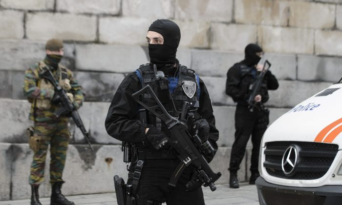 Belgian police officers and soldiers stand guard outside the Brussels Palace of Justice during the appearance before the council chamber of two individuals arrested in connection with the Nov. 13 attacks in Paris, in Brussels, on Nov. 20, 2015. (Nicolas Lambert/AFP/Getty Images)