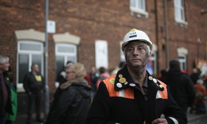 Miners, union members, and the local community take part in a protest march from Knottingley Town Hall to the Miners Welfare Center marking the end of deep coal mining in Britain, in Knottingley, England, on Dec. 19, 2015. Kellingley Colliery closed Dec. 18. The last deep mine in Britain began production in 1965. Its closure will complete a carefully managed two-year plan for the U.K.s deep mines. This has been implemented by U.K. Coal with financial support from the British government. It follows a long period of difficult trading conditions largely due to low international coal prices. (Christopher Furlong/Getty Images)