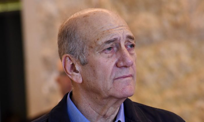 Former Israeli Prime Minister Ehud Olmert leaves the courtroom of the Supreme Court after the court ruled on his appeal in the Holyland corruption case in Jerusalem on Tuesday, Dec. 29, 2015. (Debbie Hill/Pool Photo via AP)