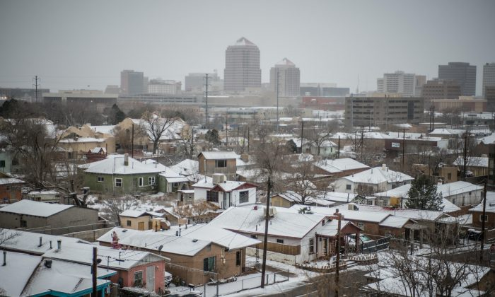 Snow covers roof tops in Albuquerque, N.M., on Dec. 26, 2015. A flurry of snow began to blanket Albuquerque, Santa Fe and other cities Saturday afternoon amid warnings of a record-setting blizzard being on the horizon. (Roberto E. Rosales/The Albuquerque Journal via AP)