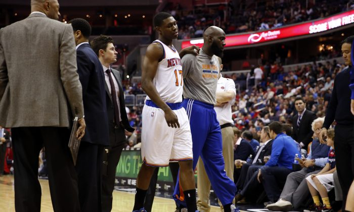 New York Knicks forward Cleanthony Early (17) walks off the court after an injury in the first half of an NBA basketball game against the Washington Wizards, Friday, April 3, 2015, in Washington. (AP Photo/Alex Brandon)
