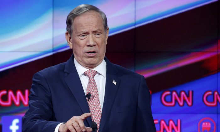 In this Dec. 15, 2015, file photo, George Pataki makes a point during the CNN Republican presidential debate at the Venetian Hotel & Casino in Las Vegas. (AP Photo/John Locher)