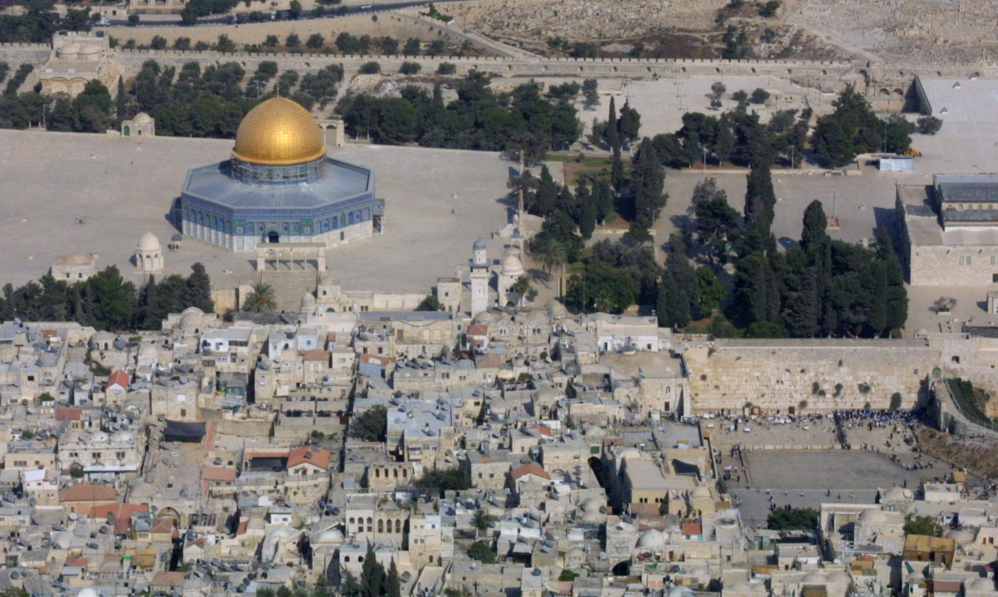 An aerial view of the Old City of Jerusalem on Sept. 24, 2002, with the Al-Aqsa mosque compound, Islam's third holiest shrine on the left, and on the right side the Western Wall, the holiest site for Jews who believe it is part of the ancient Jewish temple. (Gali Tibbon/AFP/Getty Images)