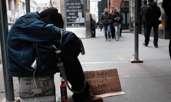 A homeless man rests on the street in New York City on Dec. 21, 2015. (Spencer Platt/Getty Images)