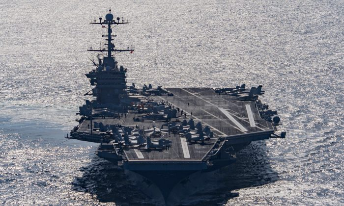 The aircraft carrier USS Harry S. Truman navigates the Gulf of Oman on Dec. 25, 2015. Iranian naval vessels conducted rocket tests last week near the USS Harry S. Truman aircraft carrier, the USS Bulkeley destroyer and a French frigate, the FS Provence, and commercial traffic passing through the Strait of Hormuz, the American military said Wednesday, Dec. 30, 2015, causing new tension between the two nations after a landmark nuclear deal. (Mass Communication Specialist 3rd Class J.M. Tolbert/U.S. Navy via AP)