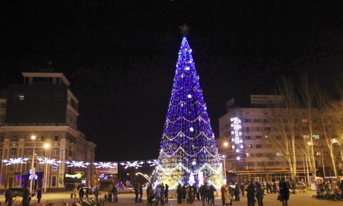An image from a video taken on Sunday, Dec.  27, 2015, shows the central square is illuminated to mark the upcoming New Year and Orthodox Christmas celebrations in Donetsk, eastern Ukraine. (AP video via AP)