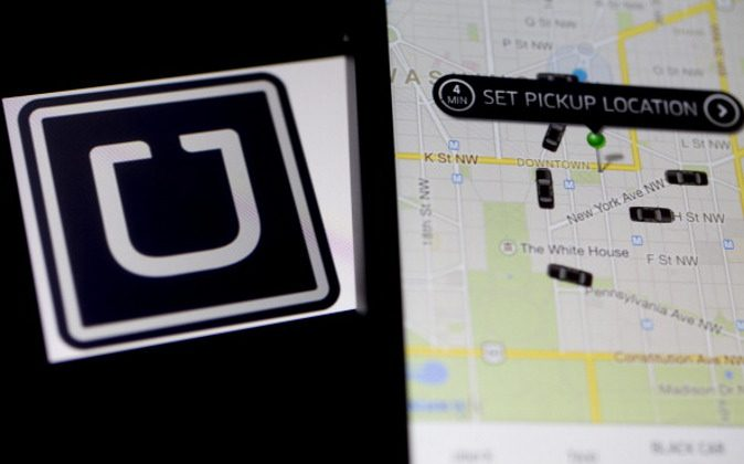 The Uber Technologies Inc. application and logo are displayed on an Apple Inc. iPhone 5s and iPad Air in this arranged photograph in Washington, D.C., on March 5, 2014. Uber, a startup that lets drivers pick up passengers with their personal cars and that was valued at $3.5 billion in a funding round last year, has raised $307 million from a group of backers that include Google Ventures, Google Inc.'s investment arm, and Jeff Bezos, the founder of Amazon. (Andrew Harrer/Bloomberg via Getty Images)