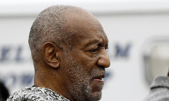 Bill Cosby leaves the Cheltenham Township Police Department where he was processed after being arraigned on a felony charge of aggravated indecent assault Wednesday, Dec. 30, 2015, in Elkins Park, Pa. (AP Photo/Matt Rourke)