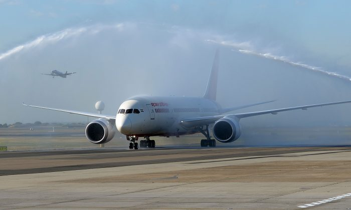 Air India's Dreamliner gets water cannon salute after touching down at Sydney airport on August 30, 2013.  Australia's first ever Dreamliner passenger flight touched down in Sydney as the airport welcomed direct services from New Delhi to Sydney with Air India.     AFP PHOTO / Saeed Khan        (Photo credit should read SAEED KHAN/AFP/Getty Images)