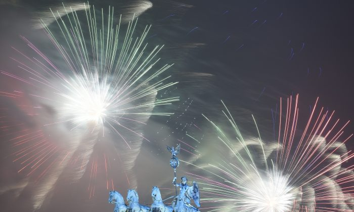 Fireworks explode behind the quadriga of Berlin's landmark Brandenburg Gate to usher in the new year on Jan. 1, 2016. (Tobias Schwarz/AFP/Getty Images)