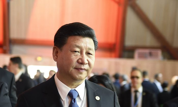 Xi Jinping, leader of the Chinese Communist Party, arrives for the plenary session at the COP 21 United Nations conference on climate change in Paris on Nov. 30, 2015. (Eric Feferberg/AFP/Getty Images)