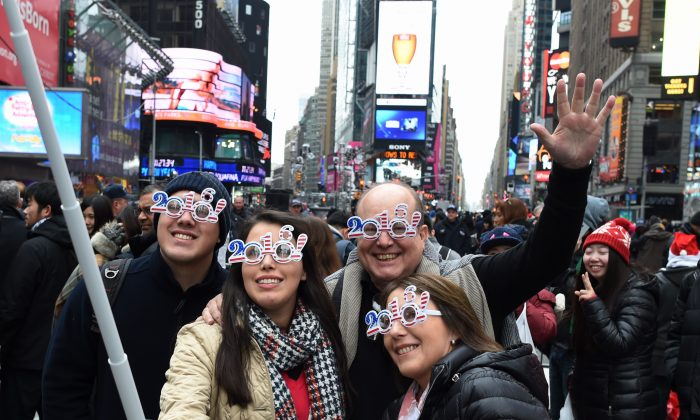 Revelers take selfies as they gather in Times Square ahead of the ball drop in New York on Dec. 31, 2015. (Don Emmert/AFP/Getty Images)