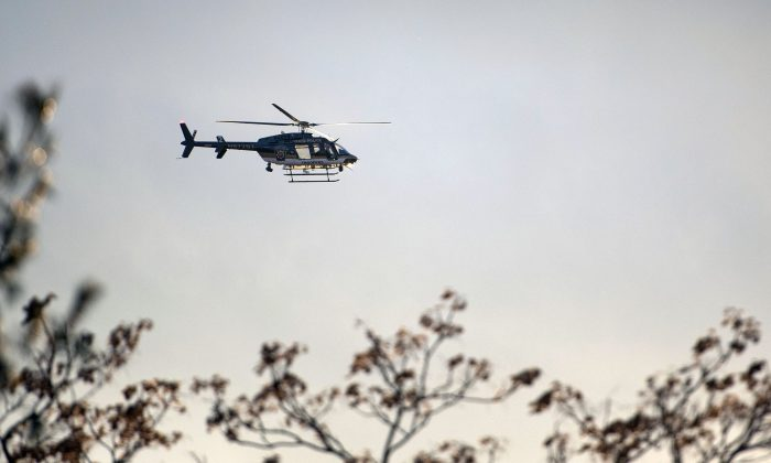 In this Friday, Jan. 1, 2016, photo, a police helicopter searches East Allentown, Pa., as the search continues in the evening for Jayliel Vega Batista, a missing 5-year-old autistic boy who wandered off from a New Year's Eve party on Thursday night. (Chris Shipley/The Morning Call via AP) THE EXPRESS-TIMES OUT; WFMZ OUT; MANDATORY CREDIT