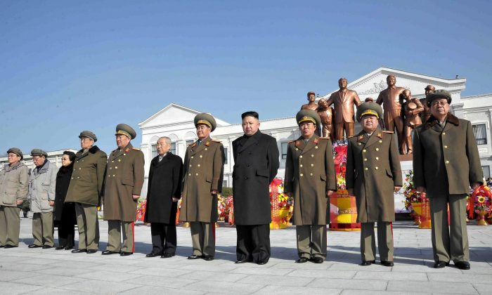 North Korean leader Kim Jong-un (4th R) and senior senior officials from the party, government and army posing before the statues of late leaders Kim Il-sung and Kim Jong-il at Mangyongdae Revolutionary School in Pyongyang as the statues were unveiled on the birth anniversary of Kim Jong-il, on on Feb. 16, 2013. (Korean Central News Agency via Getty Images)