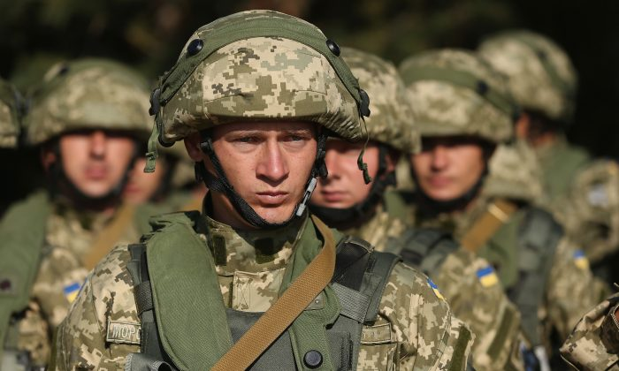 Ukrainian marines prepare to train in urban warfare techniques on the second day of the 'Rapid Trident' bilateral military exercises between the United States and Ukraine that include troops from a variety of NATO and non-NATO countries, near Yavorov, Ukraine, on Sept. 16, 2014. (Sean Gallup/Getty Images)