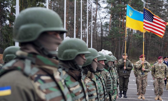 "U.S. and Ukrainian soldiers attend an opening ceremony of the joint Ukrainian-U.S. military exercise ""Fearless Guardian"" at the Yavoriv training ground in the region of Lviv on April 20, 2015. (Yuriy Dyachyshyn/AFP/Getty Images)"