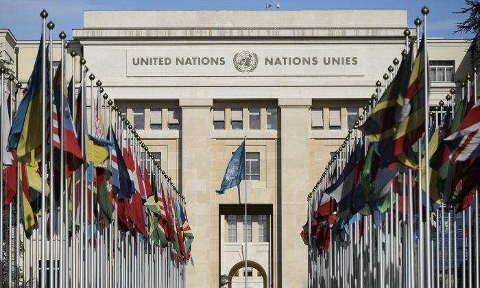 Flags hang in front of the European headquarters of the United Nations during a round of negotiations between the Syrian government and the opposition in Geneva, Switzerland, on Feb. 2, 2016. (Laurent Gillieron/Keystone via AP)