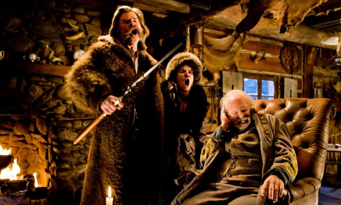 """(L-R) Kurt Russell, Jennifer Jason Leigh, and Bruce Dern, in a scene from the film, """"The Hateful Eight,"""" directed by Quentin Tarantino. (Andrew Cooper/Weinstein Company via AP)"""