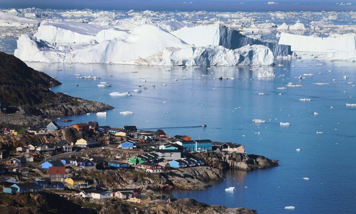 The village of Ilulissat is seen near the icebergs that broke off from the Jakobshavn Glacier in Ilulissat, Greenland, on July 24, 2013. (Joe Raedle/Getty Images)