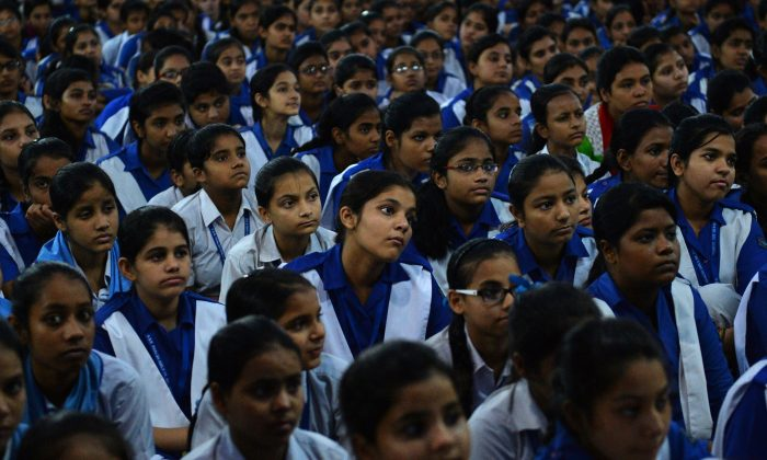 Indian schoolchildren watch a live telecast of Indian Prime Minister Narendra Modi delivering his Teachers' Day speech at a government school in the old quarters of New Delhi on Sept. 5, 2014. (Chandan Khanna/AFP/Getty Images)