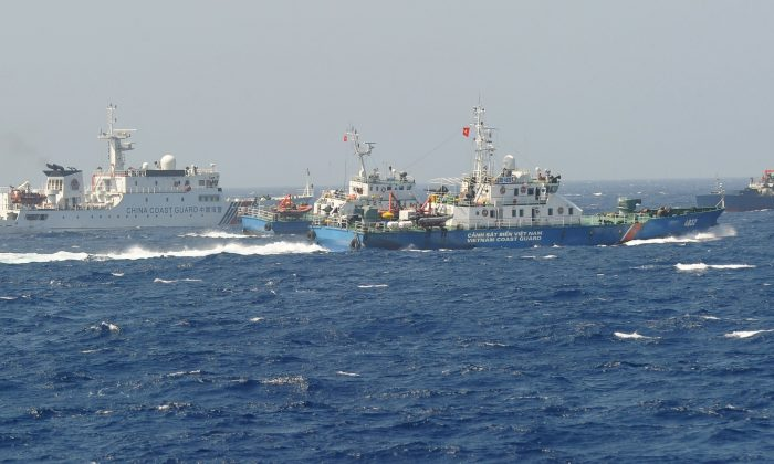 A Chinese coast guard ship (L) being blocked by three Vietnamese coast guard vessels near China's oil drilling rig in disputed waters in the South China Sea on May 15, 2014. (Hoang Dinh Nam/AFP/Getty Images)