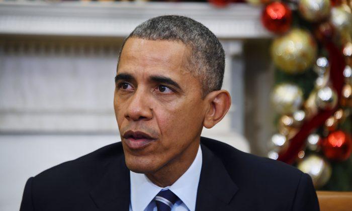 President Barack Obama speaks on U.S. gun violence at the White House in Washington, D.C., on Dec. 3, 2015. (Jim Watson/AFP/Getty Images)