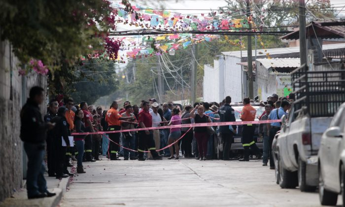 Local residents gather on Jan. 2, 2016, outside the house of Gisela Mota, newly elected Mayor of Temixco, Morelos State, Mexico, murdered on Saturday at home by gunmen. (Pedro Pardo/AFP/Getty Images)