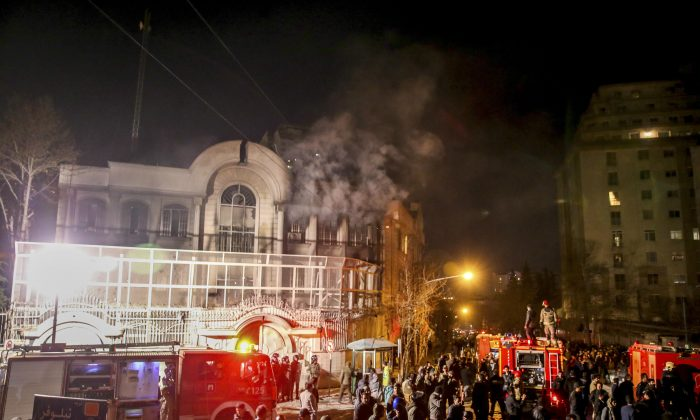 Smoke rises as Iranian protesters set fire to the Saudi Embassy in Tehran on Jan. 3, 2016. (Mohammadreza Nadimi/ISNA via AP)