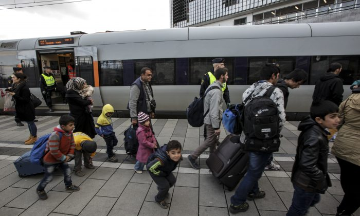 Migrants at the train station in Malmo, Sweden, on Nov. 12, 2015. (Stig Ake Jonsson/TT via AP, FILE)