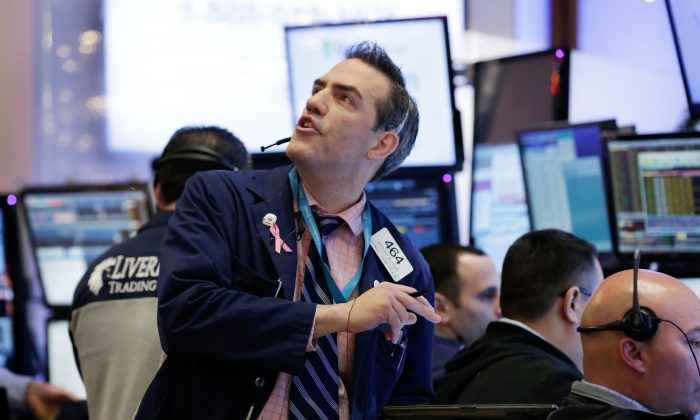 Trader Gregory Rowe works on the floor of the New York Stock Exchange, Monday, Jan. 4, 2016. (AP Photo/Richard Drew)