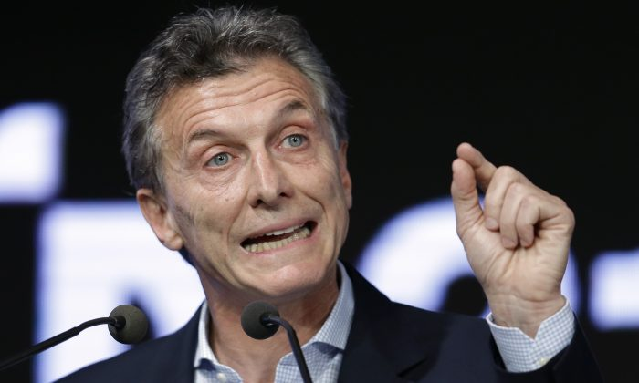 Argentina's President Mauricio Macri speaks during a meeting with the Argentine Industrial Union in Buenos Aires, Argentina, on Dec. 14, 2015. Macri is vowing to crack down on drug trafficking amid a national manhunt for three escaped prisoners convicted in drug-related killings. On Monday, Jan. 4, 2016, Macri accused the previous administration of President Cristina Fernandez of allowing drug trafficking to increase. (AP Photo/Victor R. Caivano)