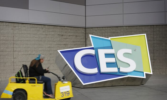 A worker drives by a sign at the Las Vegas Convention Center before the start of the International CES gadget show in Las Vegas on Jan. 3, 2016. The show officially kicks off Wednesday, Jan. 6. (AP Photo/John Locher)
