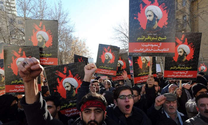 Iranian men hold portraits of Shia cleric Sheik Nimr al-Nimr during a demonstration against his execution by Saudi authorities, on Jan. 3, 2016, outside the Saudi embassy in Tehran. Iran and Iraq's top Shiite leaders condemned Saudi Arabia's execution of Nimr, warning ahead of protests that the killing was an injustice that could have serious consequences. (Atta Kenare/AFP/Getty Images)