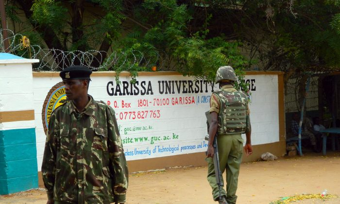 Armed security officers guard the entrance of Garissa university college, in Garissa, Kenya, Monday, Jan. 4, 2016. (AP Photo)