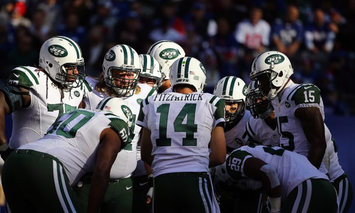 Ryan Fitzpatrick (C) and the New York Jets won 10 games this season but failed to make the postseason for the fifth time in a row. (Al Bello/Getty Images)