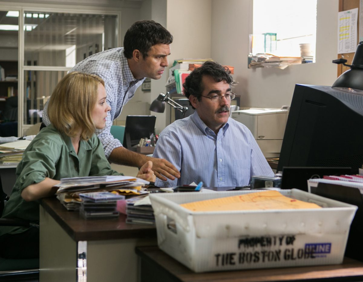"woman and two men at desk in ""Spotlight"""