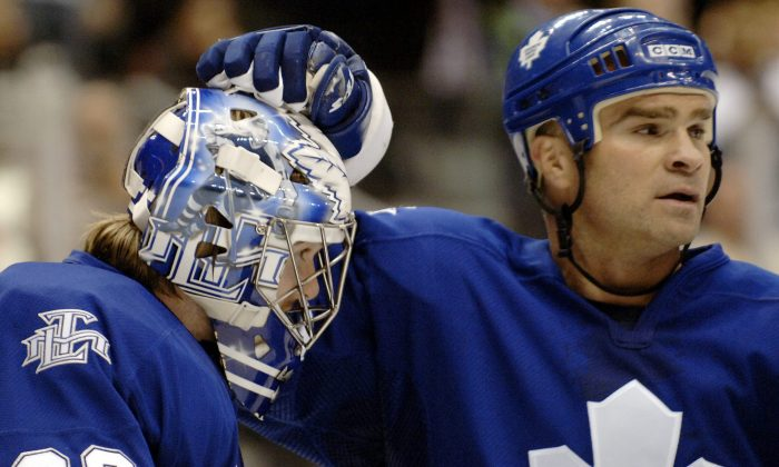 The Toronto Maple Leafs Tie Domi, right, and goalie Mikael Tellqvist celebrate their 5-1 win over the Tampa Bay Lightning in Toronto Saturday, March 11, 2006. (CP PHOTO/Aaron Harris)
