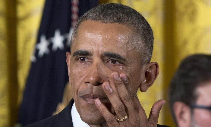 President Barack Obama wipes away tears as he speaks in the East Room of the White House on Jan. 5, 2016. (AP Photo/Carolyn Kaster)