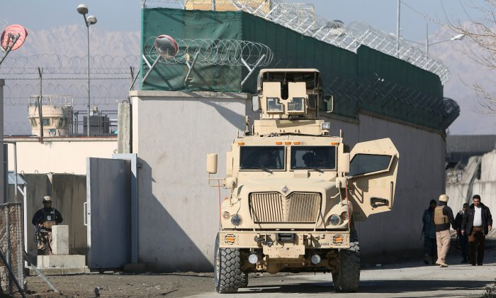 A U.S. military vehicle blocks a road to a logistics company near the site of a deadly suicide attack Monday night in Kabul, Afghanistan, on Jan. 5, 2016. The Taliban have claimed responsibility for the attack near the Kabul International Airport which killed several people and wounded at least 36 civilians, including nine women. (AP Photo/Rahmat Gul)
