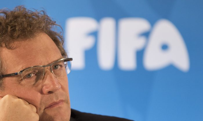 FIFA Secretary General Jerome Valcke listen to questions during a news conference to present the new world cup song at the Maracana stadium in Rio de Janeiro, Brazil, on Jan. 23, 2014. (AP Photo/Felipe Dana)
