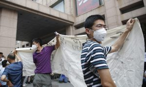 Four Months After Tianjin Blast, Victims Seek Relief