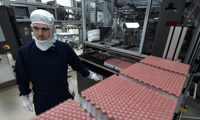 An employee works in an unit dedicated to the production of insulin pens at the factory of the US pharmaceutical company Eli Lilly in Fegersheim, eastern France, on October 12, 2015. US pharmaceutical company Eli Lilly produces mostly insulin for the international market. (Frederick Florin/AFP/Getty Images)