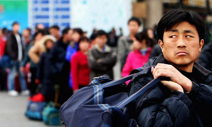 A migrant workers at the West Railway Station in Beijing on Feb. 2, 2009. (Guang Niu/Getty Images)