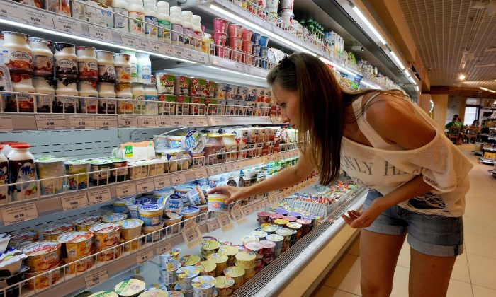 A woman shops for yogurt, a food commonly associated with good gut bacteria known as probiotics. (OLGA MALTSEVA/AFP/Getty Images)