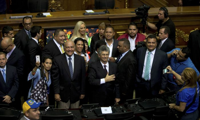 Henry Ramos Allup, incoming congress president, greets members of the news media upon his arrival to the National Assembly in Caracas, Venezuela, on  Jan. 5. (AP Photo/Fernando Llano)