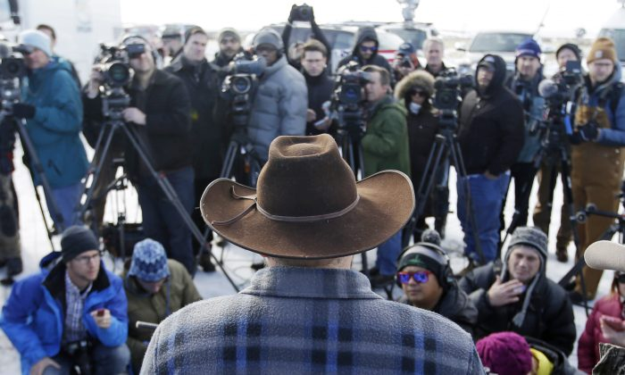 Ammon Bundy, one of the sons of Nevada rancher Cliven Bundy, speaks to reporters during a news conference at Malheur National Wildlife Refuge Wednesday, Jan. 6, 2016, near Burns, Ore. (AP Photo/Rick Bowmer)