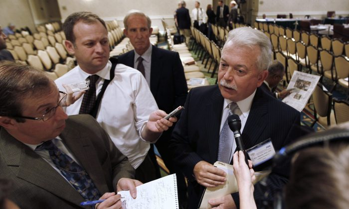 AquaBounty CEO Ron Stotish speaks to reporters during a break at a Food and Drug Administration advisory committee hearing in Rockville, Maryland, on Sept. 20, 2010. Environmental groups may appeal a court ruling that quashed their bid to overturn federal approval of the production of AquaBounty's genetically modified salmon eggs in P.E.I. (AP Photo/Charles Dharapak)