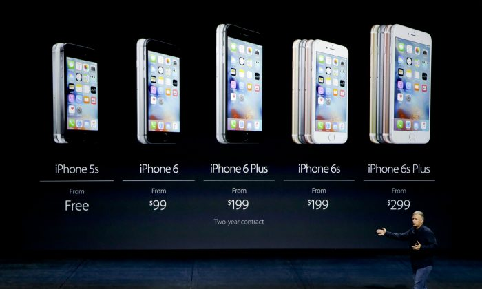 """Phil Schiller, Apple's senior vice president of worldwide marketing, talks about the pricing of the new iPhone 6s and iPhone 6s Plus during the Apple event at the Bill Graham Civic Auditorium in San Francisco on Sept. 9, 2015. Apple fans keep buying iPhones, but Wall Street keeps worrying the company won't be able to match last year's blistering sales pace. Those fears were compounded Wednesday, Jan. 6, 2016, when the Wall Street Journal said one of Apple's most important contractors is sending some workers home on """"early holiday"""" before the Chinese New Year in February. (AP Photo/Eric Risberg)"""