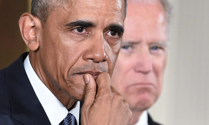President Barack Obama gets emotional as he speaks on reducing gun violence in the East Room of the White House in Washington, D.C., on Jan. 5, 2016. At right is Vice President Joe Biden. (Mandel Ngan/AFP/Getty Images)